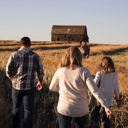 Family in the field in the fall